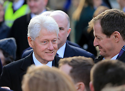 © Licensed to London News Pictures. 23/03/2017. Londonderry, UK. Former US President Bill Clinton (L) speaks with Alister Campbell outside of St Columba's Church in Londonderry, Northern Ireland 23 March, 2017 during the funeral of Sinn Féin's Martin McGuinness. Mr McGuinness, a former IRA leader turned politician, died on Tuesday.. Photo credit: LNP