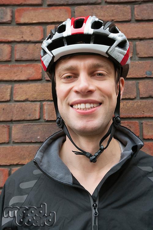 Portrait of happy biker wearing crash helmet