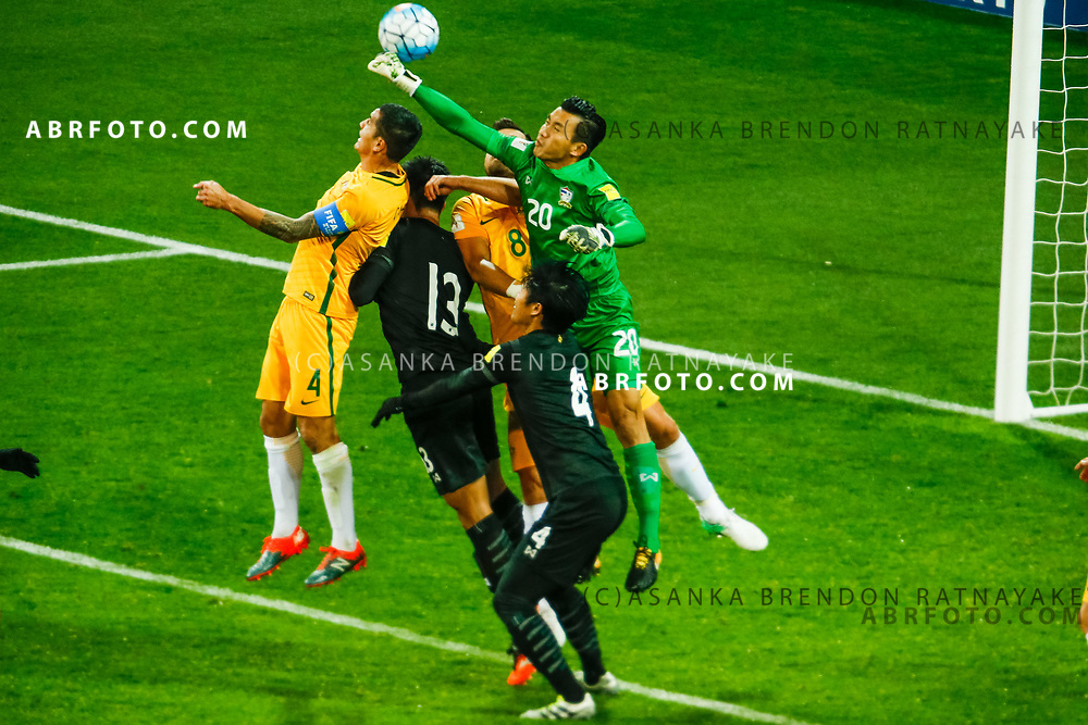 MELBOURNE, AUSTRALIA - SEPTEMBER 5 :  Sinthaweechai Hathairattanakool of Thailand punches the ball out of the pack during the Stage 3 Group World Cup Football Qualifiers between Australia Vs Thailand at the Melbourne Rectangular Stadium, Melbourne, Australia 5 September 2017.