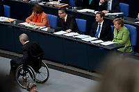 21 MAY 2010, BERLIN/GERMANY:<br /> Wolfgang Schaeuble (L), CDU, Bundesfinanzminister, nach seiner Rede, auf dem Weg zu seinem Platz, in der Regierungsbank: Sabine Leutheusser-Schnarrenberger, FDP, Bundesjustizministerin, Thomas de Maiziere, CDU, Bundesinnenminister, Guido Westerwelle, FDP, Bundesaussenminister, und Angela Merkel, CDU, Bundeskanzlerin, (v.L.n.R.), Bundestagsdebatte ueber den Entwurf eines Gesetzes zur Uebernahme von Gewaehrleistungen im Rahmen eines europäischen Stabilisierungsmechanismus, Plenum, Deutscher Bundestag<br /> IMAGE: 20100521-01-069<br /> KEYWORDS: Euro-Rettungspaket, Euro-Notpaket, Wolfgang Schäuble, Gesetz ueber den Deutschen Buergschaftsanteil fuer den Euro-Rettungsschirm