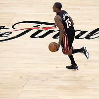 14 June 2012: Miami Heat point guard Mario Chalmers (15) brings the ball upcourt during the Miami Heat 100-96 victory over the Oklahoma City Thunder, in Game 2 of the 2012 NBA Finals, at the Chesapeake Energy Arena, Oklahoma City, Oklahoma, USA.