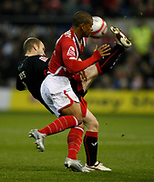 Photo: Steve Bond/Richard Lane Photography. Nottingham Forest v Doncaster Rovers. Coca Cola Championship. 28/11/2009. Gareth Roberts (back) hooks clear of Garath McCleary (front)