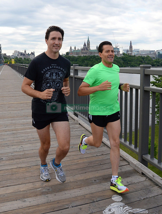 Prime Minister Justin Trudeau and Mexican President Enrique Pena Nieto run across the Alexandra Bridge from Ottawa to Gatineau, Quebec, Canada on June 28, 2016. Photo by Sean Kilpatrick/The Canadian Press/ABACAPRESS.COM  | 553158_004 Ottawa Canada