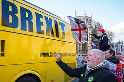 London, UK. 11th December, 2018. Pro-Brexit activists jeer at a bus commissioned by anti-Brexit activists as it passes Parliament on the day on which a vote was originally to have been scheduled on completion of a House of Commons debate on the Government's draft Brexit withdrawal agreement.