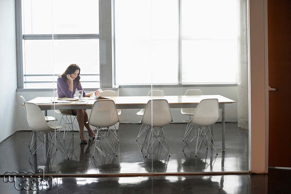 Business woman sitting in conference room