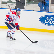 A.J. White #18 of the UMass Lowell Riverhawks in action during the Frozen Fenway game between The Northeastern Huskies and The UMass Lowell Riverhawks at Fenway Park on January 11, 2014 in Boston, Massachusetts.