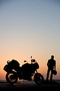 essaouira, morocco, motorcycle on the beach at sunset