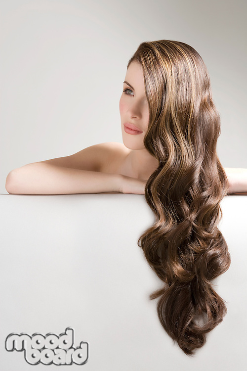 Woman with long brown wavy hair