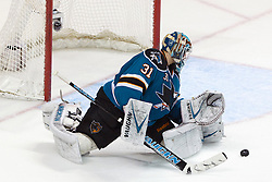 Jan 17, 2012; San Jose, CA, USA; San Jose Sharks goalie Antti Niemi (31) saves a shot against the Calgary Flames during the overtime period at HP Pavilion. San Jose defeated Calgary 2-1 in shootouts. Mandatory Credit: Jason O. Watson-US PRESSWIRE