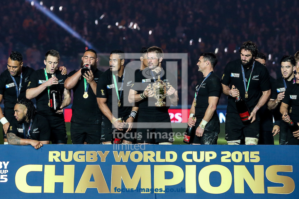 Richie McCaw of New Zealand (centre) holds the World Cup trophy after the final of the 2015 Rugby World Cup at Twickenham Stadium, Twickenham<br /> Picture by Andy Kearns/Focus Images Ltd 0781 864 4264<br /> 31/10/2015