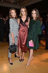 Left to right, sisters LADY VIOLET MANNERS, LADY ALICE MANNERS and LADY ELIZA MANNERS at a party to celebrate the publication of Capability Brown & Belvoir - Discovering a lost Landscape by The Duchess of Rutland, held at Christie's, 8 King Street, St.James, London on 7th October 2015.