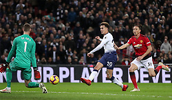 Manchester United goalkeeper David de Gea blocks a shot from Tottenham Hotspur's Dele Alli