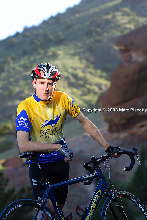 SHOT 6/10/08 6:18:24 PM - Dan Grunig, 39, of Denver, Co. is the Executive Director of Bicycle Colorado, a state-wide nonprofit focused on building a bicycle friendly environment in Colorado. The group focuses on education, legislation, policy work and trail construction. Grunig said that the price of gas topping the $4.00 a gallon mark has definitely sparked a renewed interest in biking and bike commuting. Grunig was photographed at Red Rocks Park in Morrison, Co. just outside of Denver..(Photo by Marc Piscotty / © 2008)