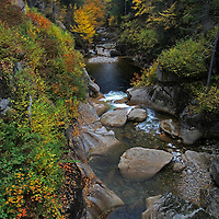 Outdoor landscape photography images of this beautiful autumn scenery at Liberty Gorge from the Franconia Notch State Park of the White Mountains in New Hampshire are available as museum quality photography prints, canvas prints, acrylic prints or metal prints. Prints may be framed and matted to the individual liking and decorating needs:<br />