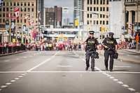 Ontario Provincial Police officers were called in for extra security and were patrolling around the Ottawa Canada Day site near Parliament Hill, on this 150th Canada Day, in 2017. Assault rifles are increasingly becoming a comon sight around these parts.