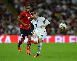 England's Wayne Rooney (Manchester United) plays the ball. - Photo mandatory by-line: Alex James/JMP - Mobile: 07966 386802 - 3/09/14 - SPORT - FOOTBALL - London - Wembley Stadium - England v Norway - International Friendly