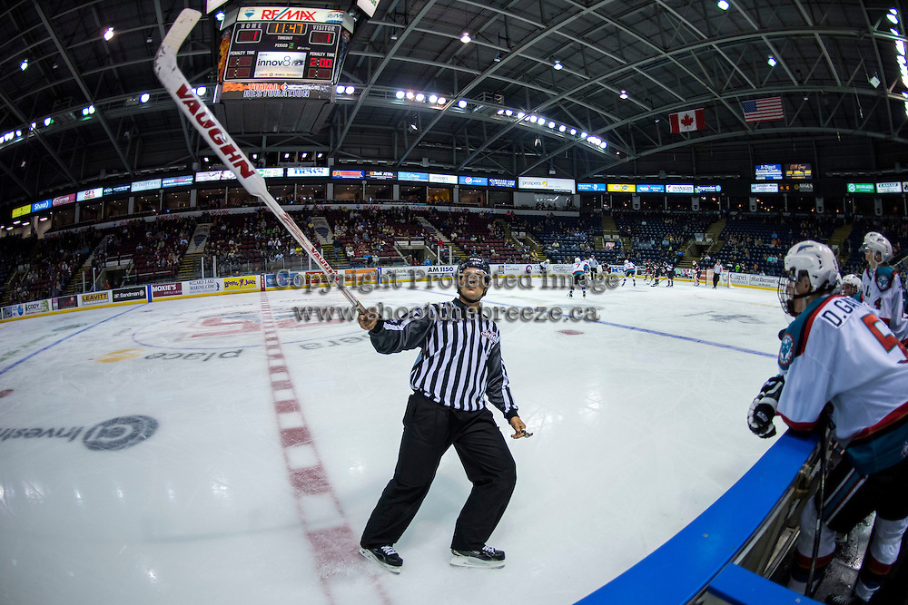 KELOWNA, CANADA - SEPTEMBER 5: Linesman Dustin Minty returns a broken goalie stick to the bench of the Prince George Cougars on September 5, 2015 during the first pre-season game at Prospera Place in Kelowna, British Columbia, Canada.  (Photo by Marissa Baecker/Shoot the Breeze)  *** Local Caption *** Dustin Minty;