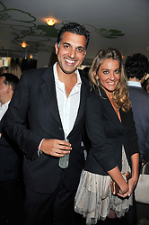 DINO LALVANI and VANESSA FERNANDEZ at a party to celebrate the launch of Jax Coco - a new soft drink, held at Harvey Nichols 5th Floor Bar, 109-125 Knightsbridge, London on 25th June 2012.