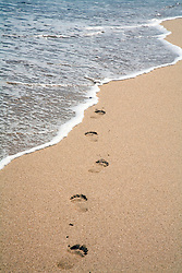 Guanacaste Province:  Footprints into the surf.  Conchal Beach (Playa Conchal) on the central Pacific coast.