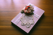 antique book with lace; flowers & reading glasses; rectangle