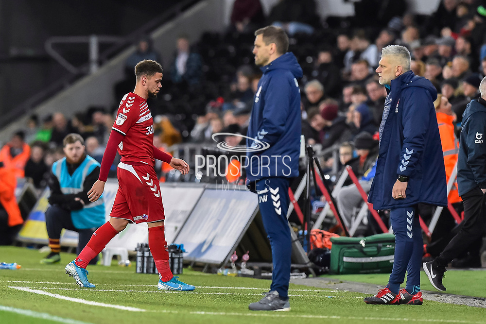 Marcus Browne (10) of Middlesbrough looks dejected as he walks off past Middlesbrough manager Jonathan Woodgate after being shown a red card during the EFL Sky Bet Championship match between Swansea City and Middlesbrough at the Liberty Stadium, Swansea, Wales on 14 December 2019.