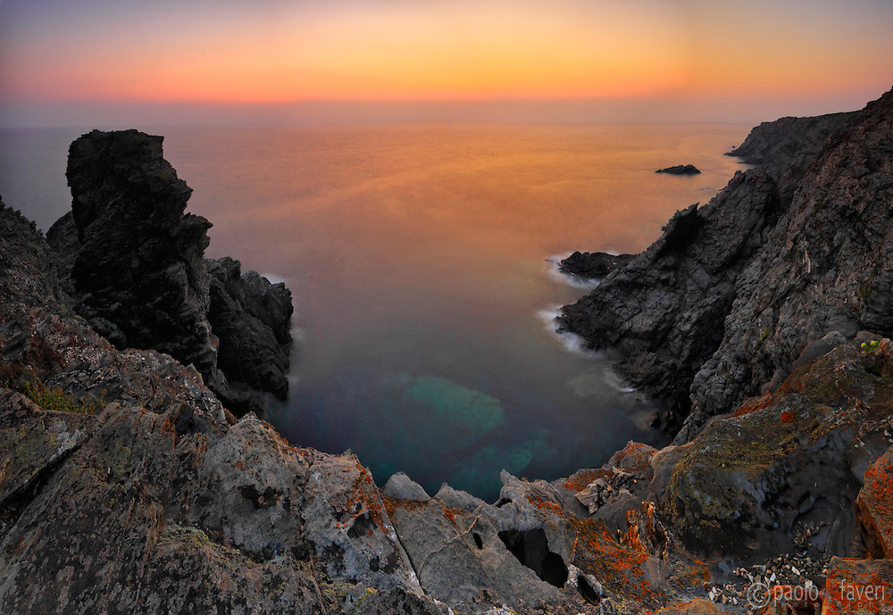 The rocky coast of Capo Falcone at sunset. Capo Falcone is a rocky promontory at the north-western tip of Sardinia, Italy, right in face of the Island of Asinara