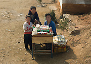 NORTH KOREA:<br /> The pictures Kim Jong Un doesn't want you to see<br /> <br /> Since 2008, Eric Lafforgue ventured to North Korea six times. Thanks to digital memory cards, I was able to save photos that I was forbidden to take or was told to delete by the minders.<br /> <br /> Photo Shows:  For a long time, bans against black market sales have been strictly enforced. Grey market vendors are more common. They earn a little money selling cigarettes or sweets.<br /> ©Eric Lafforgue/Exclusivepix Media