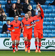 Lukas Jutkiewicz of Bolton Wanderers (right)  celebrates scoring the opening goal during the Sky Bet Championship match at The Den, London<br /> Picture by David Horn/Focus Images Ltd +44 7545 970036<br /> 15/02/2014