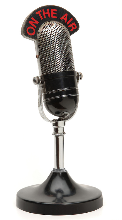 old broadcast microphone on white background