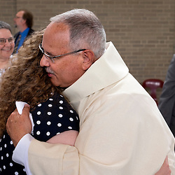 4 JUNE 2016 -- ST. LOUIS -- Deacon Timothy Woods, of St. Catherine Laboure parish, accepts congratulations from his niece Margaret Woods at a reception in Boland Hall following the Ordination of Deacons at the Cathedral Basilica of St. Louis Saturday, June 4, 2016 in St. Louis. Eighteen men from across the Archdiocese were ordained.<br /> <br /> Photo by Sid Hastings.