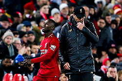 Naby Keita of Liverpool cuts a frustrated figure as he walks past Liverpool manager Jurgen Klopp after being substituted - Mandatory by-line: Robbie Stephenson/JMP - 30/01/2019 - FOOTBALL - Anfield - Liverpool, England - Liverpool v Leicester City - Premier League