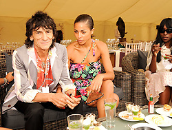 Asprey World Class Cup polo held at Hurtwood Park Polo Club, Ewhurst, Surrey on 17th July 2010.<br /> Picture shows:- RONNIE WOOD and ANA ARAUJO