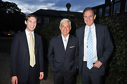 Left to right, WILLIAM AITKEN, SIMON REUBEN and JONATHAN AITKEN at a Summer party hosted by Lady Annabel Goldsmith at her home Ormeley Lodge, Ham, Surrey on 14th July 2009.