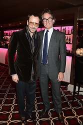 Left to right, TOM FORD and TIM JEFFERIES at a party to celebrate the publication of 'Passion for Life' by Joan Collins held at No41 The Westbury Hotel, Mayfair, London on21st October 2013.