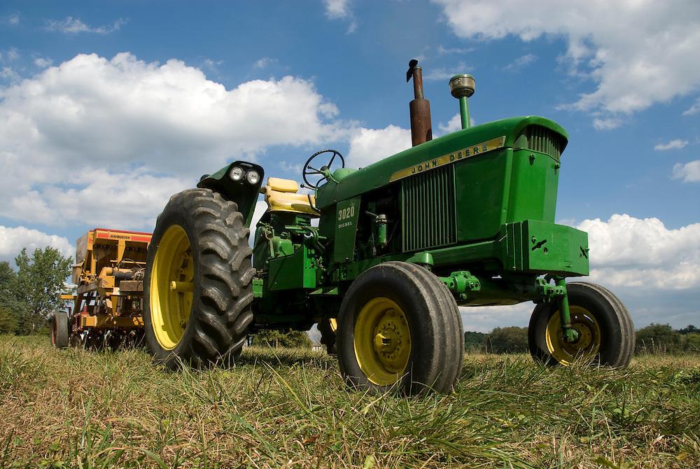 John Deere tractor with no till planter
