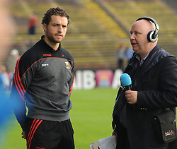Mayo&rsquo;s injured midfielder Tom Parsons being interview for radio on the sideline at halftime.<br />