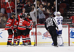 Jan 29, 2010; Newark, NJ, USA; The New Jersey Devils celebrate a goal by New Jersey Devils left wing Zach Parise (9) during the first period at the Prudential Center.