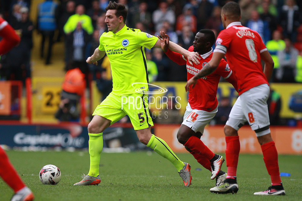 Brighton central defender Lewis Dunk shields the ball from Charlton Athletic striker Igor Vetokele during the Sky Bet Championship match between Charlton Athletic and Brighton and Hove Albion at The Valley, London, England on 23 April 2016. Photo by Bennett Dean.