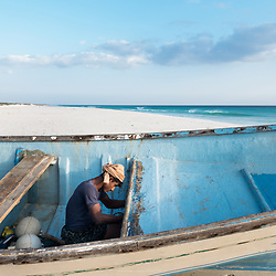 Dec. 25, 2014 - Socotra, Yemen. A fisherman sorts out a boat after coming back from fishing in Neet. Fishing is a stable source of income for many of the people of Socotra. © Nicolas Axelrod / Ruom