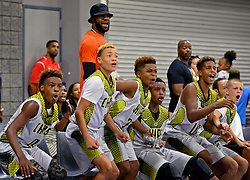 July 21, 2017 - Charlotte, NC, USA - NBA star LeBron James, center/back facing camera, reacts along with his son, LeBron Jr., left and his teammates on a play during a youth tournament at the Charlotte Convention Center in Charlotte, N.C., on Friday, July 21, 2017. (Credit Image: © Jeff Siner/TNS via ZUMA Wire)