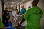 Ohio University President M. Duane Nellis helps a student move into Jefferson Hall on East Green.