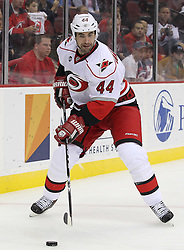 Oct 10; Newark, NJ, USA; Carolina Hurricanes defenseman Jay Harrison (44) skates with the puck during the second period at the Prudential Center.