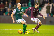David Gray (#2) of Hibernian FC keeps the ball from Marcus Godinho (#26) of Heart of Midlothian during the Ladbrokes Scottish Premiership match between Hibernian FC and Heart of Midlothian FC at Easter Road Stadium, Edinburgh, Scotland on 29 December 2018.