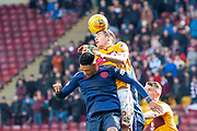 Alex Rodreguez Gorrin (#23) of Motherwell FC wins a header against Sean Clare (#9) of Heart of Midlothian during the Ladbrokes Scottish Premiership match between Motherwell FC and Heart of Midlothian FC at Fir Park, Stadium, Motherwell, Scotland on 17 February 2019.