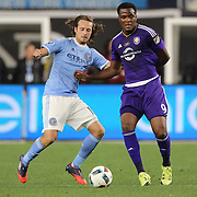 Cyle Larin, (right), Orlando, is challenged by Mix Diskerud, NYCFC, during the New York City FC Vs Orlando City, MSL regular season football match at Yankee Stadium, The Bronx, New York,  USA. 18th March 2016. Photo Tim Clayton