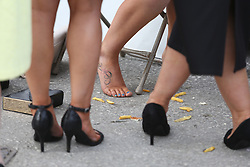 © Licensed to London News Pictures. 08/04/2016. Liverpool, UK. Chips surround the feet of tired racegoers on Ladies Day at the Grand National 2016 at Aintree Racecourse near Liverpool. The race, which was first run in 1839, is the most valuable jump race in Europe. Photo credit : Ian Hinchliffe/LNP