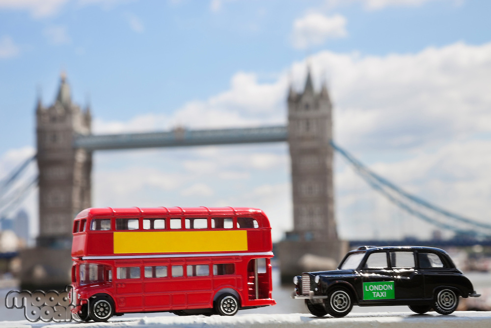 Close-up view of public transport figurines with London Bridge in the background