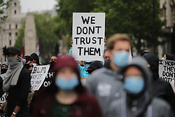 © Licensed to London News Pictures. 06/06/2020. London, UK. Protesters gather in Parliament Square for a Black Lives Matter demonstration. Protests have taken place across the United States and in cities around the world in response to the killing of George Floyd by police officers in Minneapolis on 25 May. Photo credit: Rob Pinney/LNP