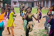 Next to her best friend Anju Kumari, 13, (left) Tabasum Khatun, 14, is throwing a kick during a Karate class in Algunda village, pop. 1000, Giridih District, rural Jharkhand, India.