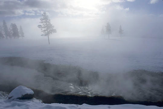 Yellowstone National Park, Steam rising from thermal spring.